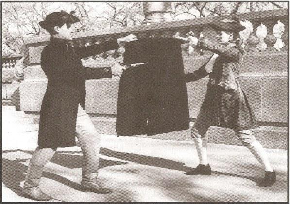 """Демонстрация дуэли через плащ или плед по Donald McBane, известного шотландского мастера фехтования, написавшего работу """"Expert Sword-man's Companion"""", 1728 год."""